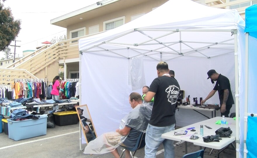 Barber services and clothes offered at the Humanity Showers event at Potter's House in Oceanside. May 12, 2021.