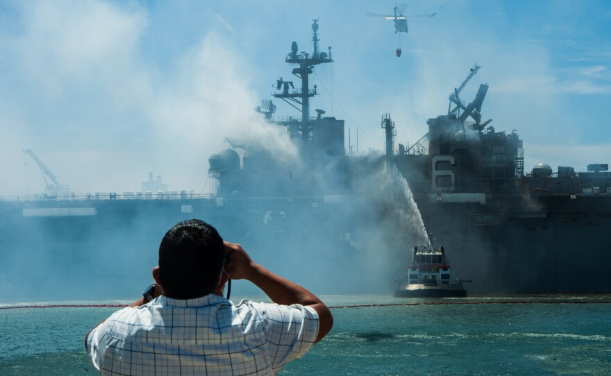 Fire still burns on the second day after fire on board the USS Bonhomme Richard, July 13, 2020.