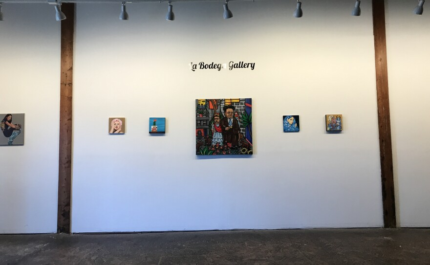 Art hangs on a wall at La Bodega Art Gallery in this photo dated Dec. 5, 2019.