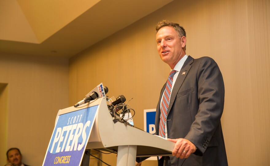 Democratic Rep. Scott Peters talks to supporters election night, when returns showed he was in a tight race with Republican challenger Carl DeMaio, Nov. 4, 2014.