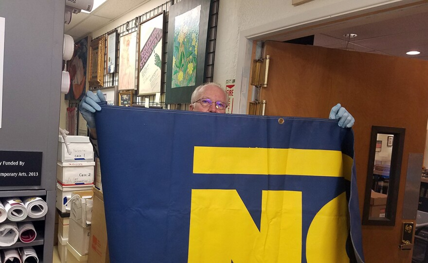 Walter Meyer, the manager of Lambda Archives, shows a 'No on 64' banner, May 14, 2019.