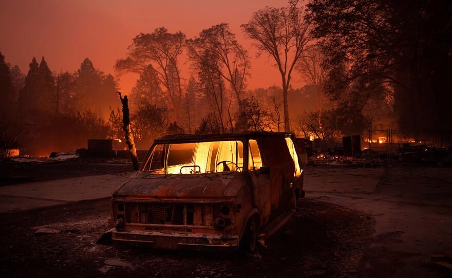 Flames burn inside a van as the Camp Fire tears through Paradise, Calif., on Thursday, Nov. 8, 2018.