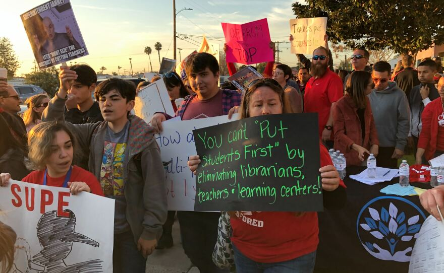Parents, teachers and students protest on Monday, Feb. 23, 2020, Sweetwater Union High School District's proposed layoffs of more than 200 employees.