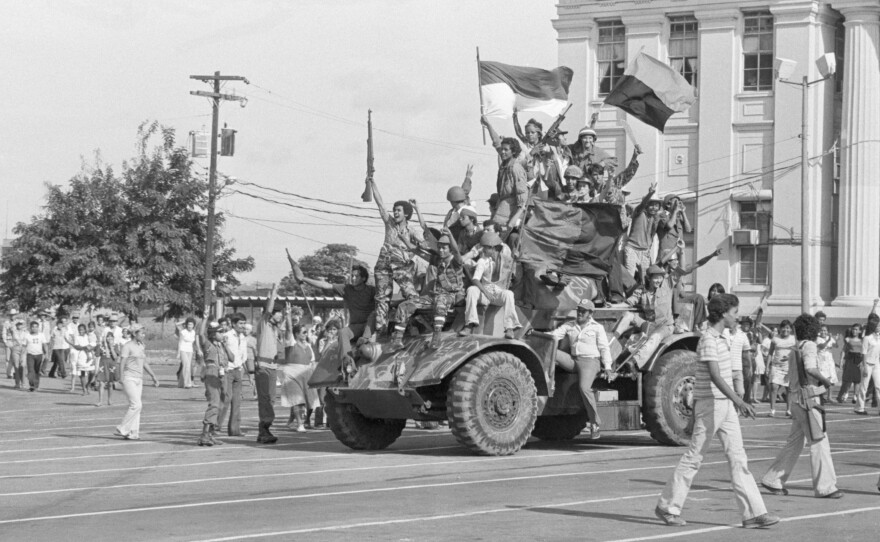 Sandinista rebels ride an armored vehicle through Managua, the Nicaraguan capital, on July 19, 1979, after ousting dictator Anastasio Somoza. Latin America has endured civil wars for the past six decades, but only two groups, the Sandinistas and Fidel Castro's rebels, ousted leaders by force.