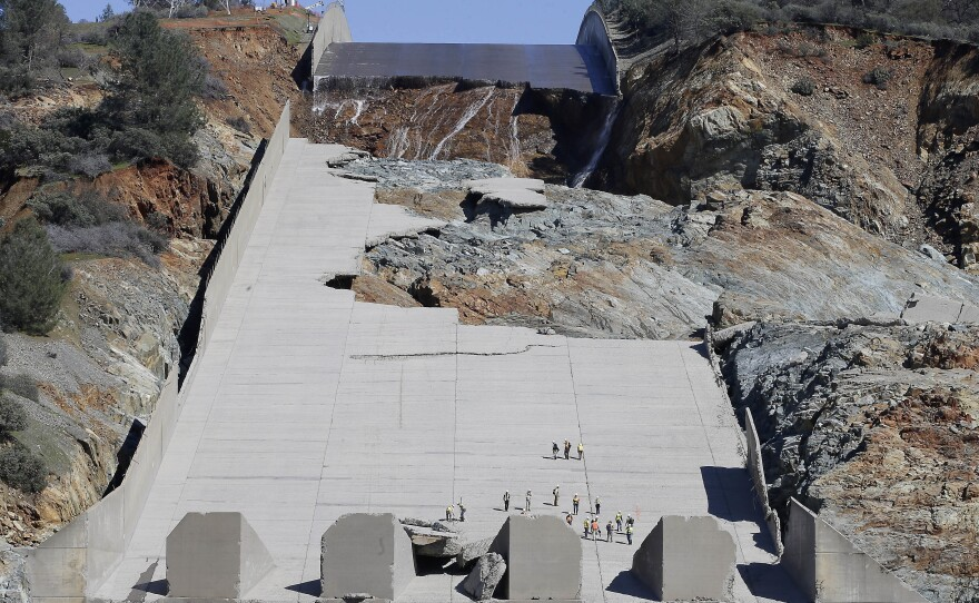 Officials inspect Oroville Dam's crippled spillway in Oroville, Calif., Feb. 28, 2017.