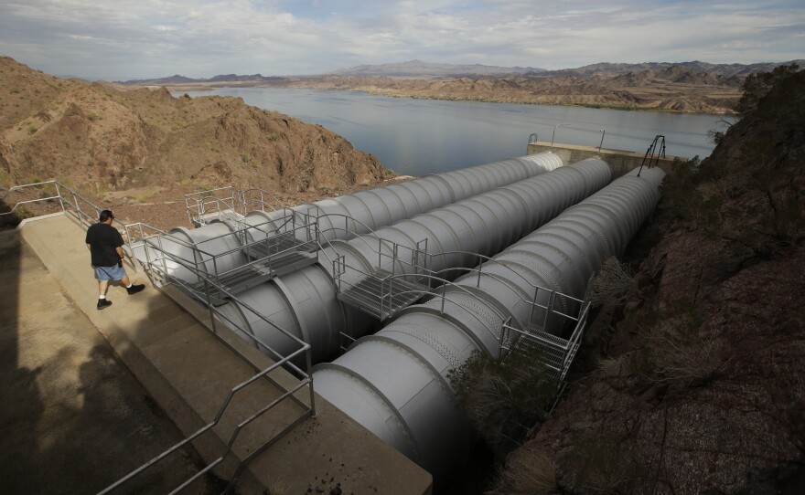 Mechanic John Harper walks onto the pipes conveying water pumped from the Colorado River at the Metropolitan Water District of Southern California's Whitsett Intake Pumping Plant near Parker Dam, California, Oct. 15, 2015.