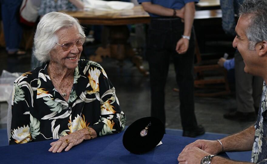 Kevin Zavian (right) appraises an 1890 Patek Philippe & Tiffany pocket watch in Honolulu, Hawaii.