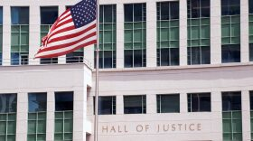 The U.S. flag waving in front of the Hall of Justice in downtown San Diego on June 12, 2019.