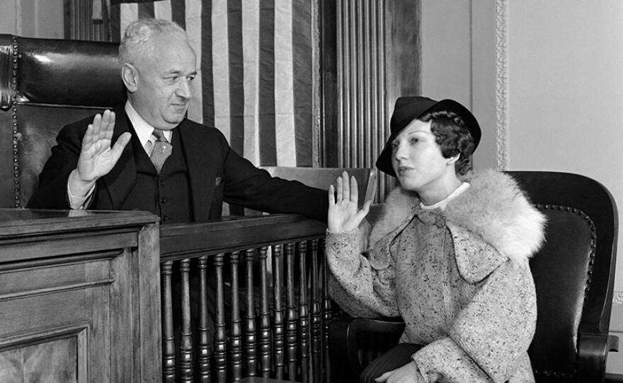 Ann Cooper Hewitt being sworn in before testifying to municipal judge Sylvain J. Lazarus, 1936.