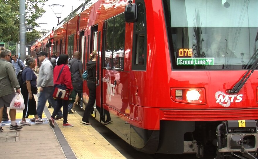 Commuters board the San Diego Trolley near Old Town on June 20, 2013.