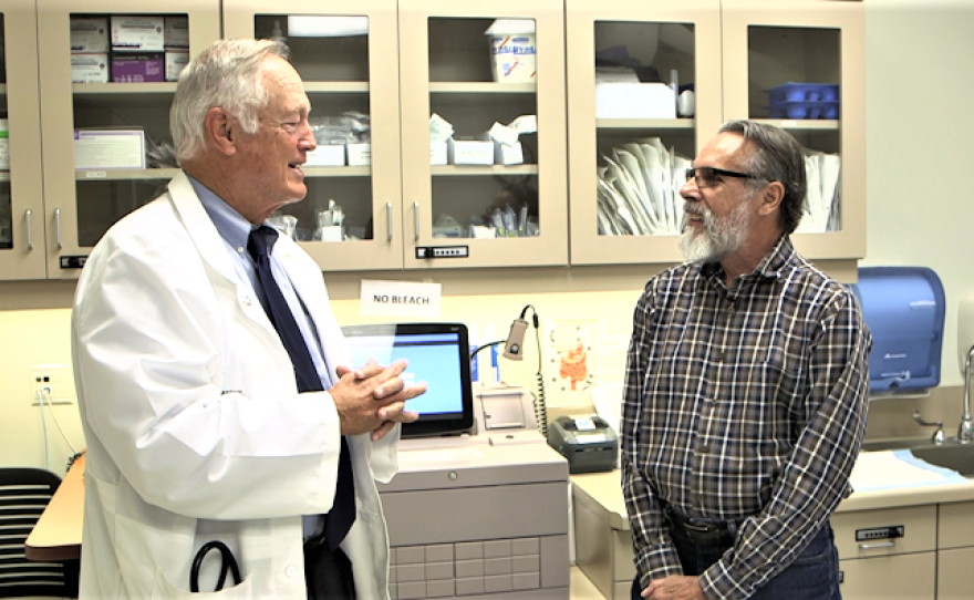 Dr. Daniel Anderson visits with colorectal cancer survivor Walter Roussell, March 7, 2018.