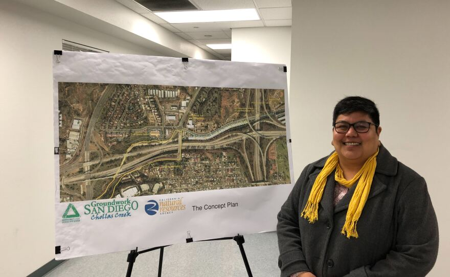 San Diego City Council President Georgette Gómez stands next to a map of City Heights, where the Chollas Creek will be restored, Dec. 23, 2019.