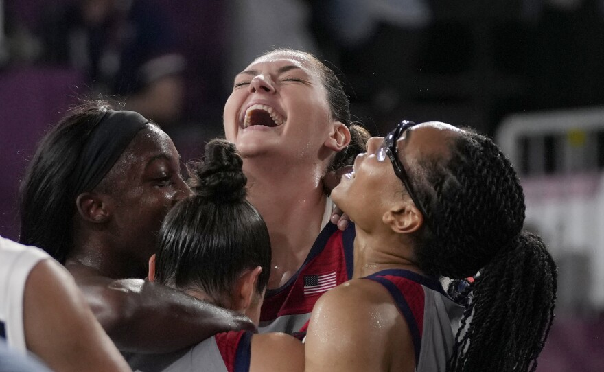 U.S. players Stefanie Dolson, Jacquelyn Young, Kelsey Plum and Allisha Gray celebrate after defeating the team from Russia in the women's 3-on-3 gold medal basketball game at the Summer Olympics on Wednesday.