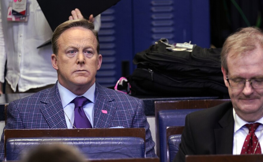 Former White House press secretary Sean Spicer and reporter for Newsmax, top left, listens during a coronavirus task force briefing at the White House in March.