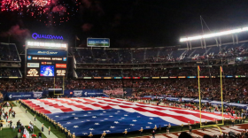 Marines unfurl the Holiday Bowl Big Flag during the bowl's pregame show in San Diego, Dec. 30, 2015.