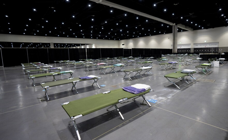 Cots laid out for unaccompanied migrant teens temporarily sheltering at the San Diego Convention Center, March 27, 2021.