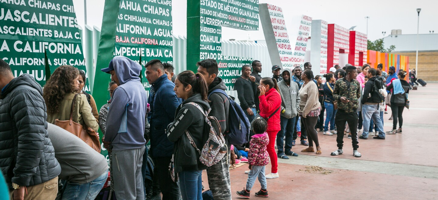A line of asylum-seekers wait at the Pedwest crossing in Tijuana, Oct. 25, 2018.