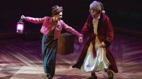 Cathryn Wake as Ghost of Christmas Present and Robert Joy as Ebenezer Scrooge