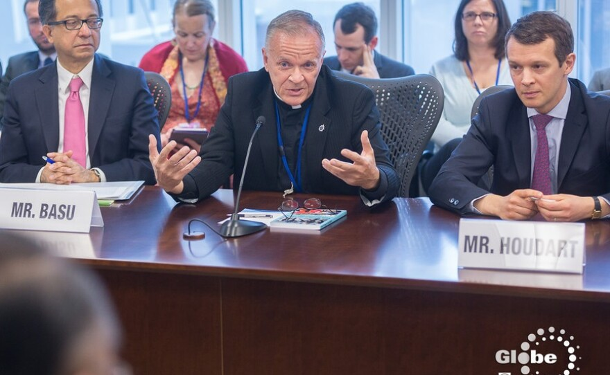 Rev. Albert Ogle discussing LGBT poverty issues with leaders from different countries at this year's World Bank spring meeting.