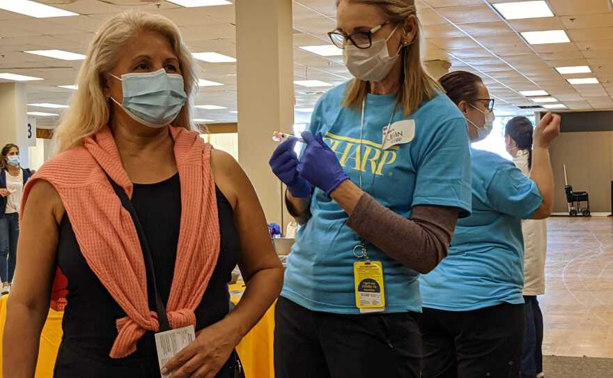 Adriana Moyal received her first dose of the COVID-19 vaccine at the Chula Vista superstation, Jan. 21, 2021.