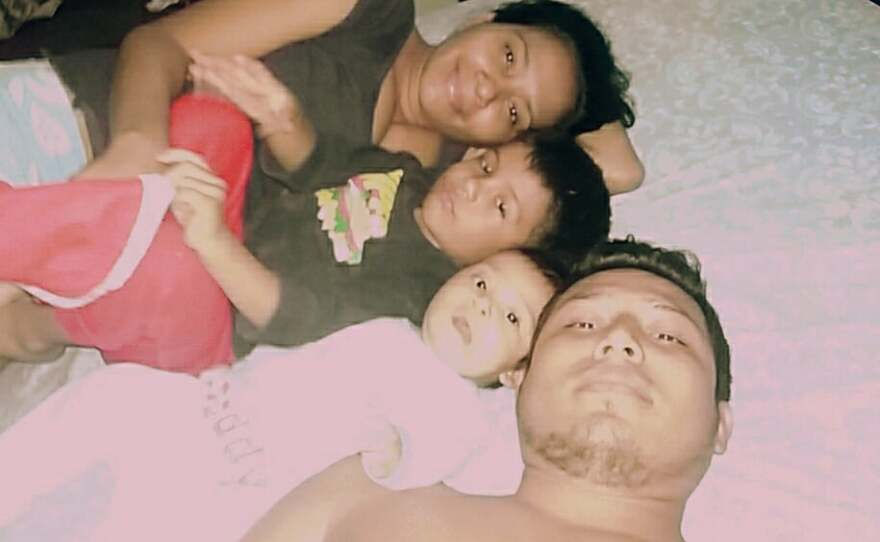 Jose Demar Fuentes rests with his family in El Salvador in this undated photo.