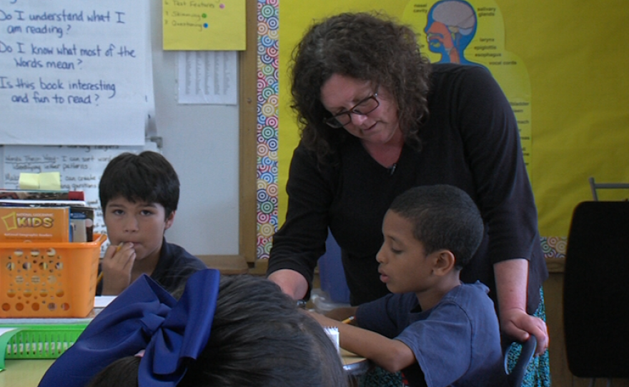 America's Finest Charter School fifth grade teacher Kim Brunetto helps a student with a writing assignment, Nov. 2, 2015.