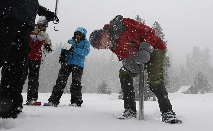 Frank Gehrke, chief of the California Cooperative Snow Surveys Program for the Department of Water Resources, checks the snowpack depth during the manual snow survey at Phillips Station near Echo Summit, Calif., March 30, 2017.