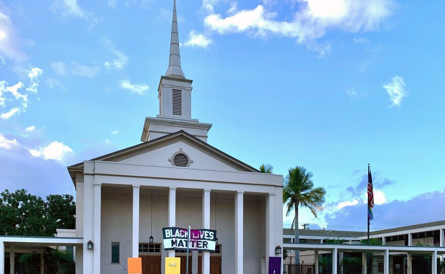 The front of the University Christian Church with its Black Lives Matter banner and rainbow color doors vandalized as seen in this photo taken Jan. 24, 2021.