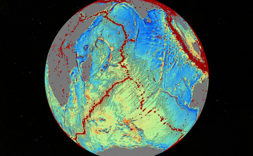 The seafloor spreads along tectonic ridges and faults, marked by the red dots overlaying this region of the Indian Ocean, Oct. 2, 2014.