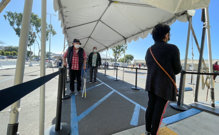 Patients waiting in line for a COVID-19 vaccine outside a vaccination super station in Chula Vista, Calif. Feb. 5, 2021.