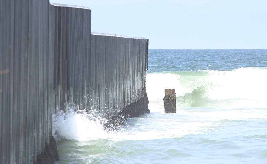 The U.S.-Mexico border fence extends into the Pacific Ocean at Imperial Beach, July 13, 2017.