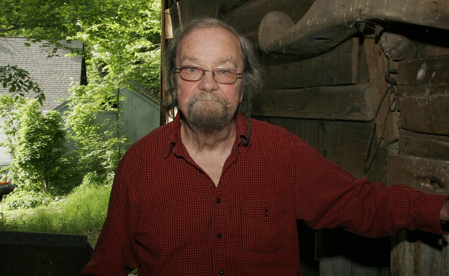 Donald Hall, former poet laureate of the United States and author of numerous poetry books, poses in 2006 in the barn of the 200-year-old Wilmot, N.H., farm that has been in his family for four generations. Hall died on Saturday at age 89.