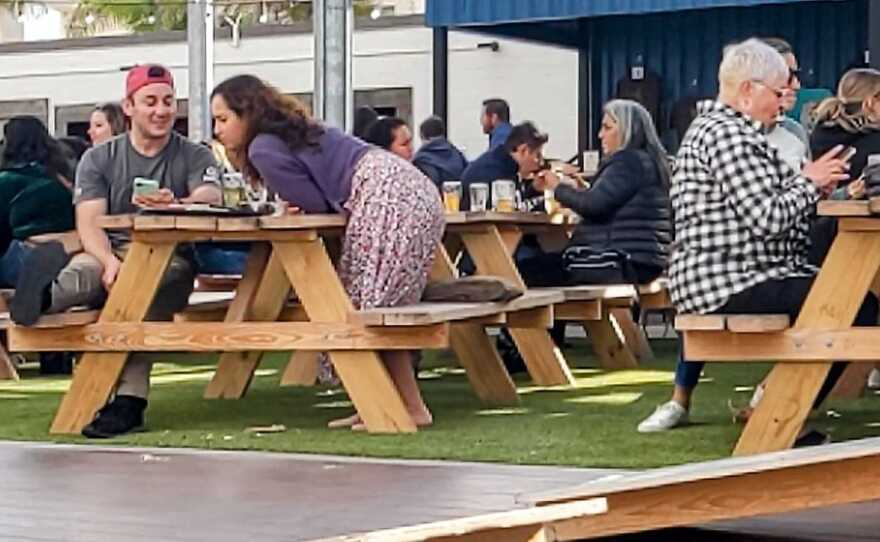 Customers dining outside at Mike Hess Brewing in Imperial Beach, May 17, 2021.