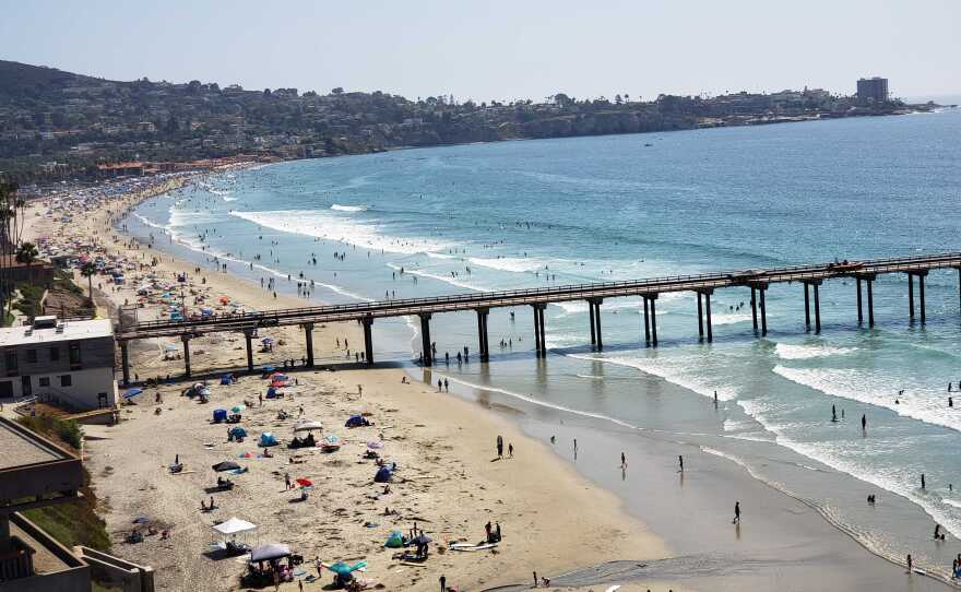 People at the beach by the Ellen Browning Scripps Memorial Pier. Aug. 22, 2020.