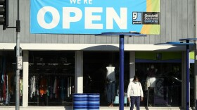 In this June 9, 2021, file photo, a sign announces that a Goodwill store is open amid the coronavirus pandemic, in Santa Monica, Calif.