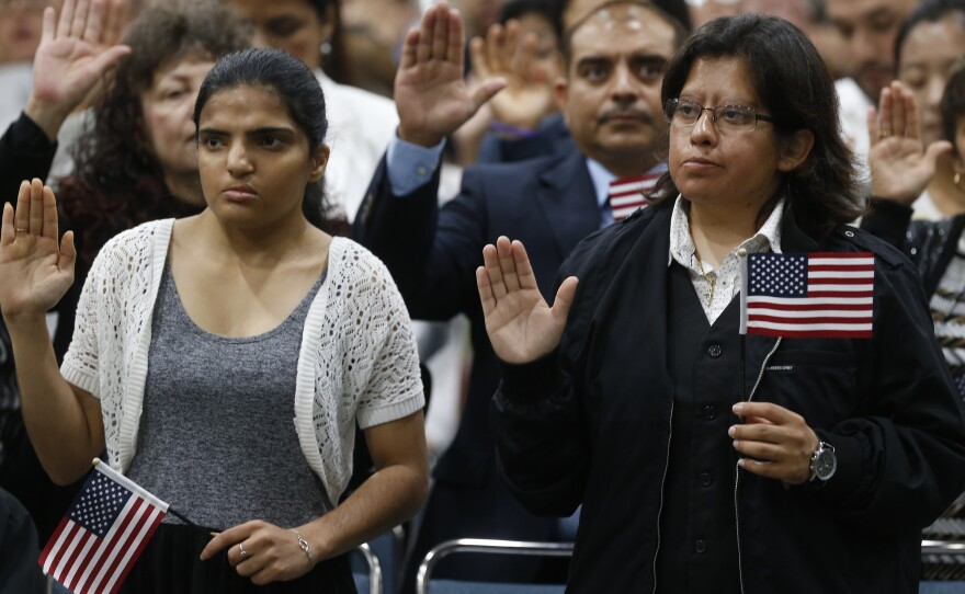Guadalupe Gonzalez, left, joins other immigrants taking the citizenship oath during naturalization ceremonies at a U.S. Citizenship and Immigration Services (USCIS) ceremony in Los Angeles Wednesday, Sept. 20, 2017.