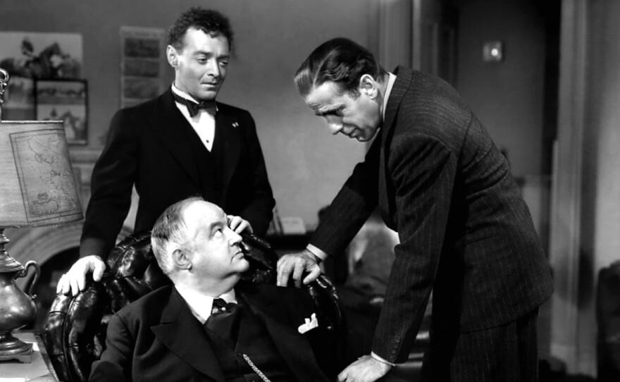 "Sam Spade (Humphrey Bogart) tangles with Joel Cairo (Peter Lorre) and Kasper Gutman (Sydney Greenstreet in his film debut) in John Huston's ""The Maltese Falcon."""