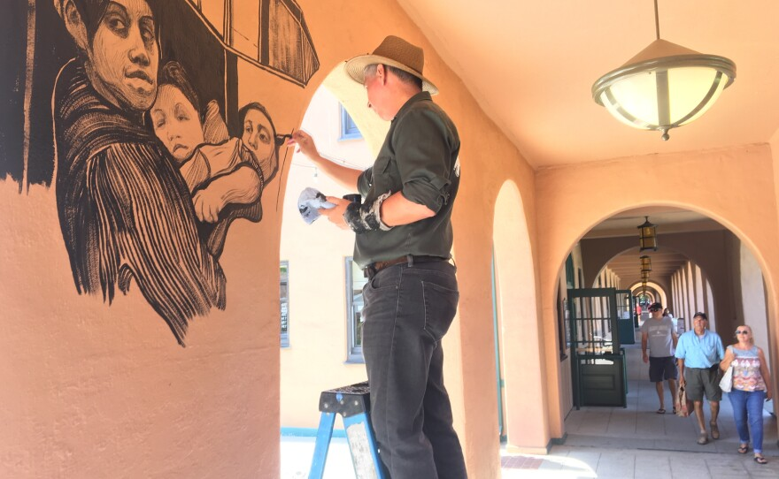Hugo Crosthwaite paints a mural in San Diego's Liberty Station, August 6, 2018.