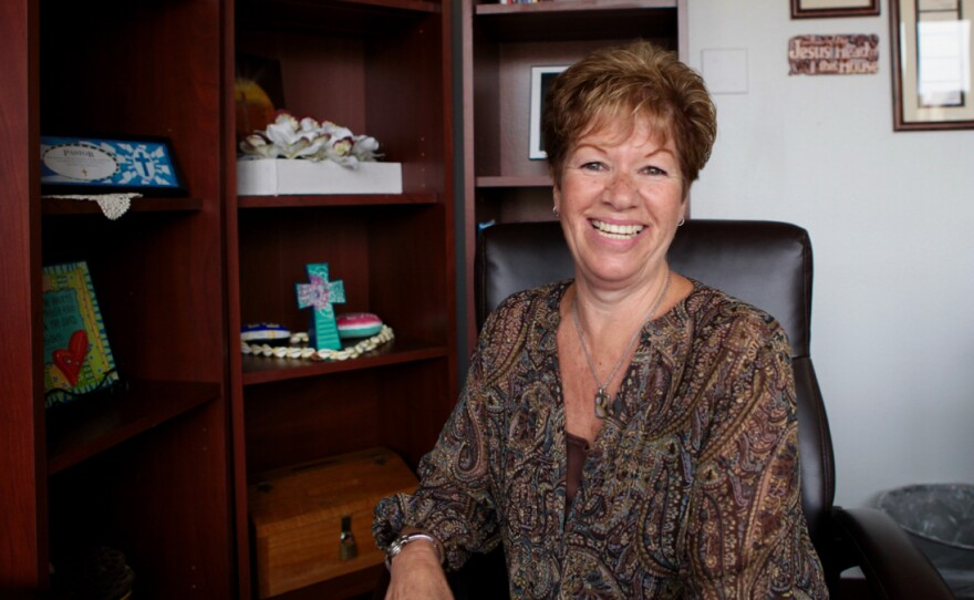 Teresa Whitney sits in front of crosses and other religious signs at the Salvation Army's office. She is a rehabilitation manager for the nonprofit. Sept. 21, 2016.