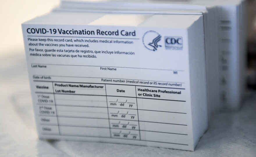 It's a stack of COVID-19 Vaccination Record Cards from the Centers for Disease Control and Prevention. They provide proof that you've had your shot — but aren't exactly wallet-size at 4-by-3 inches.